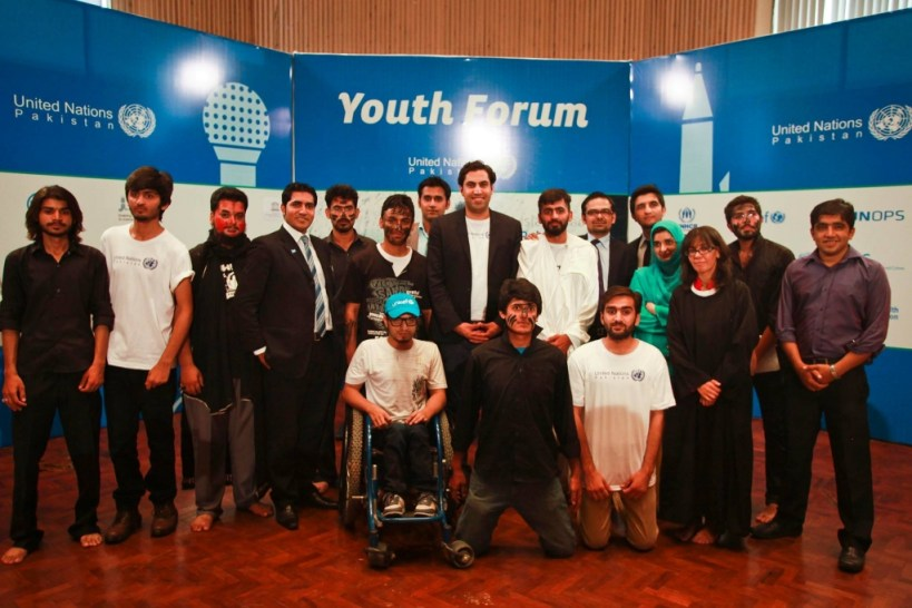 The Envoy surrounded by participants in the Youth Forum.