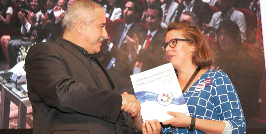 Deputy Prime Minister and Foreign Minister Nasser Judeh receives the Amman Youth Declaration's final draft from Matilda Flemming at the conclusion of the Global Forum on Youth, Peace and Security in Madaba on Saturday (Photo by Osama Aqarbeh)