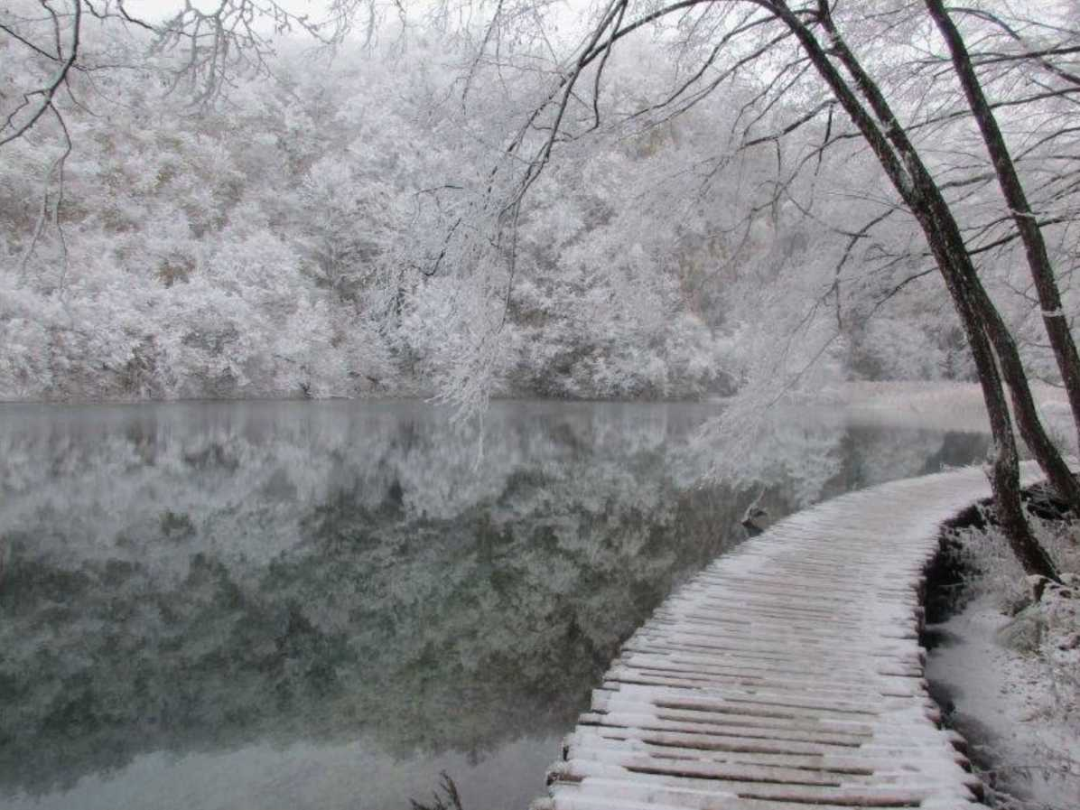 Why should I visit Plitvice national park when traveling in the Balkans?