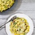Pasta con ragu di prosciutto contto piselli e formaggio asiago - Ricetta di unamammaincucina.it