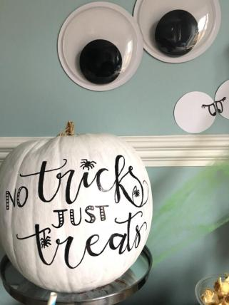 Instead of carving pumpkins, experiment with paint and hand lettering to turn them into something a little different
