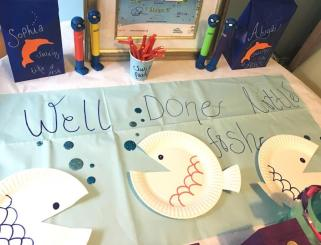 Swim party theme ideas to help celebrate swimming level achievements. Well done Little Fish! Paper plate fish decorations