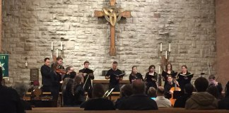 Image of a group of musicians performing in front of pews in a church