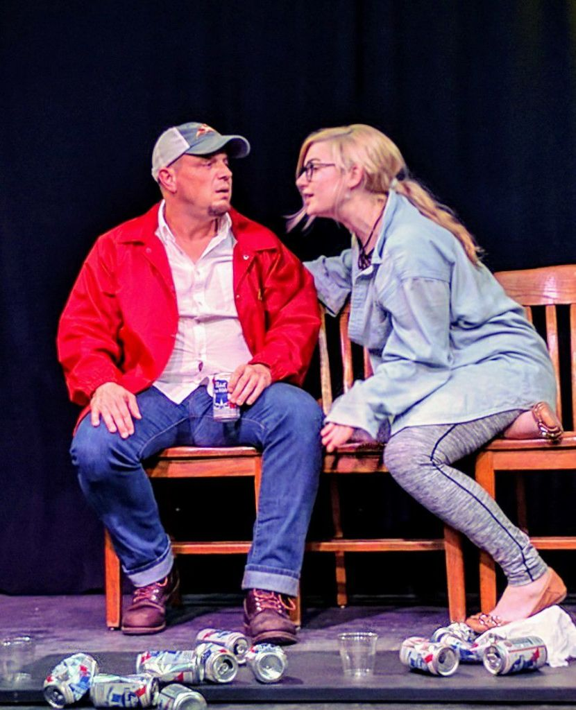 "Julie (Jessica Rosalie Bisel) asks the Pizza Man (Todd Clark), ""Do you believe in God?"""