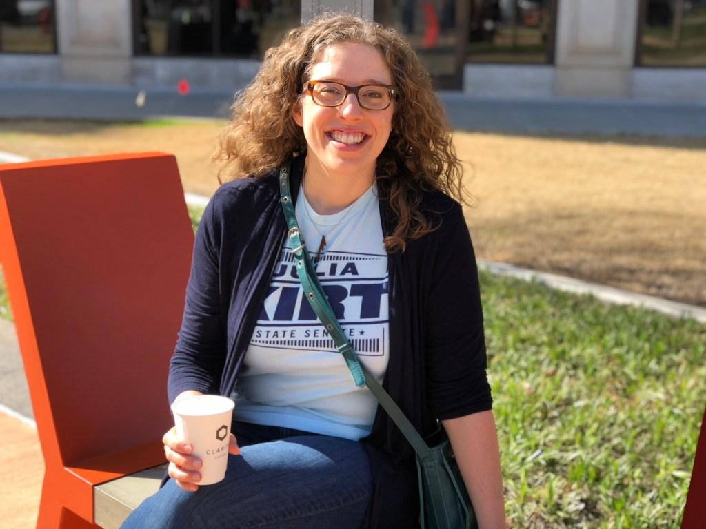 Kelsey Karper sits on Nurture by Beatriz Mayorca - photo by Dennis Spielman