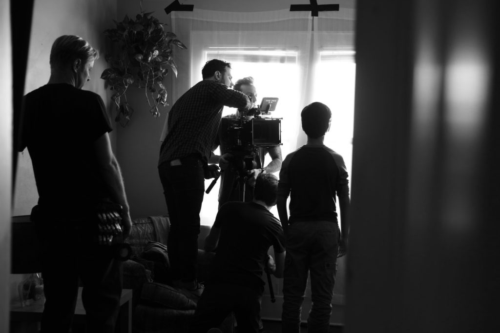 Brian Lawes, Nick Dillard, and Matt Bauske frame a shot for the opening scene of the film