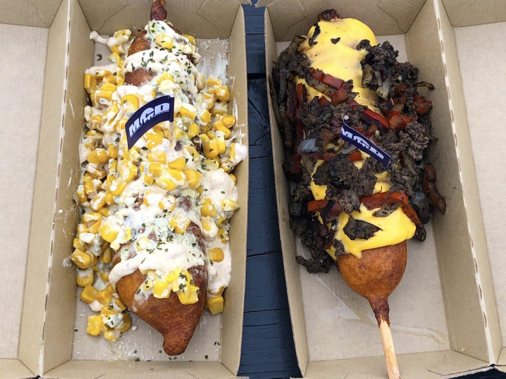 The El Chapo (left) and Yo Adrian (right) corndogs from Mighty Corn Dog Food Truck - photo by Dennis Spielman