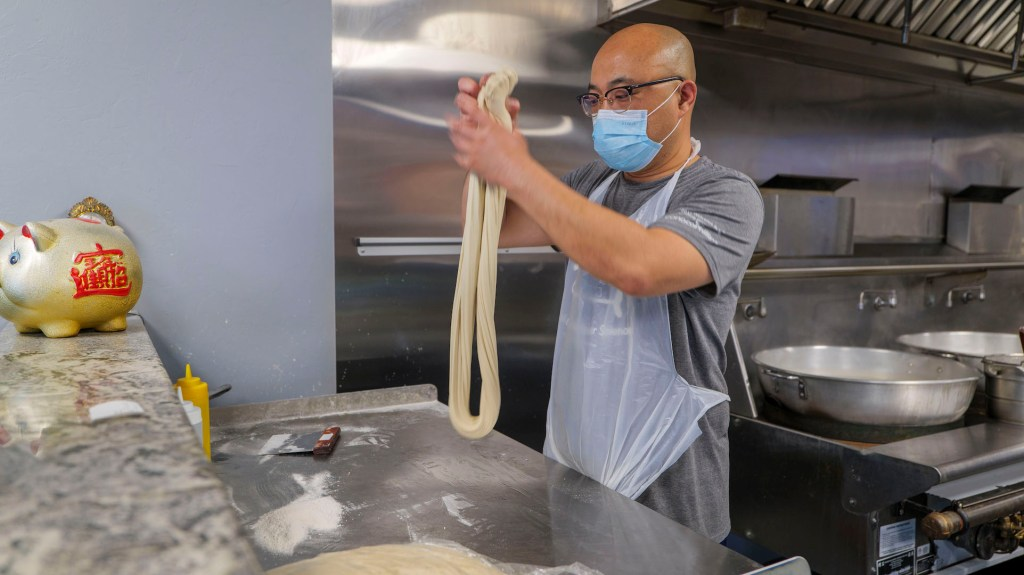 Jerry Zhao making noodles at Magic Noodle photo by Dennis Spielman