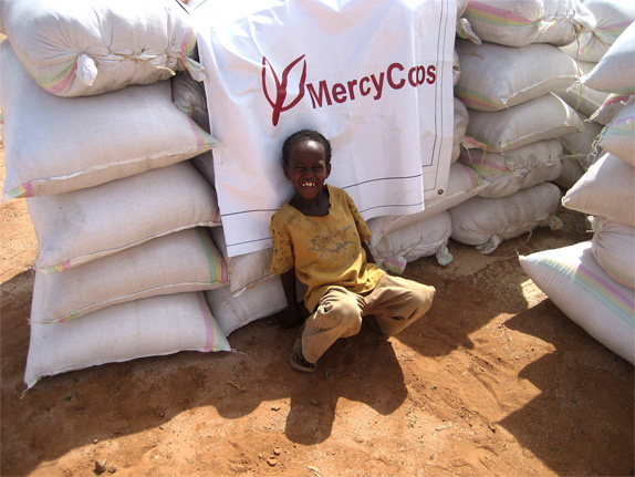 Mercy Corps Logo, In the Field