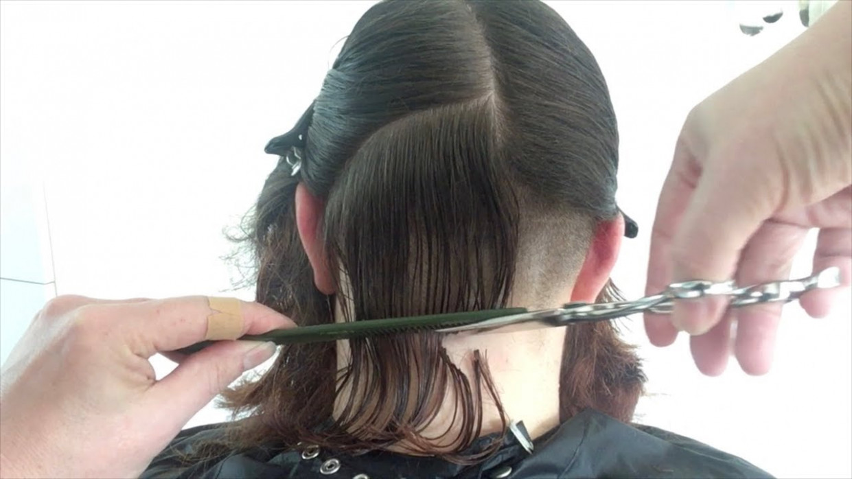 A curly bob haircut with shaved undercut shaved undercut female