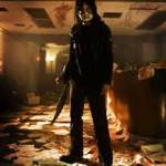 Basement Jack poses with a machete