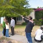 Filming a movie scene on a sidewalk