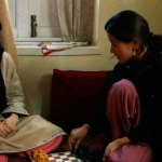 Kashmir woman teaches another about chess