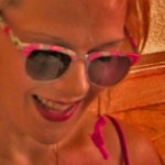 Woman wearing brightly colored sunglasses