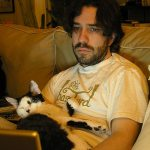 Kent Lambert remixes some media while his special cat Mochi keeps a watchful eye.