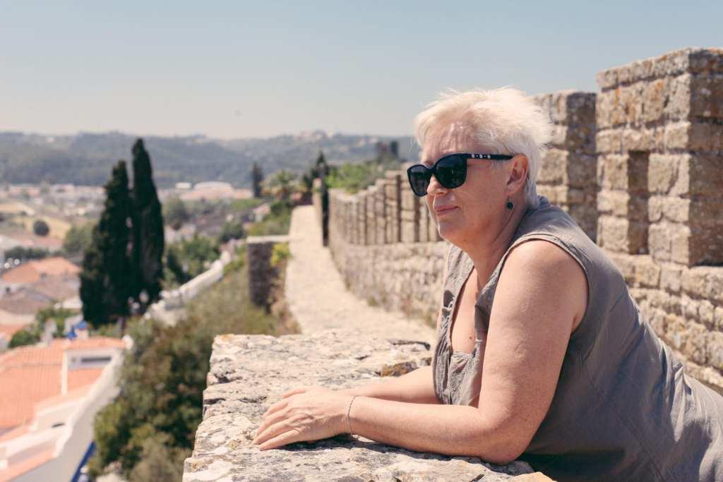 An older woman travel solo in Europe ©   dabyki.nadya/Shutterstock