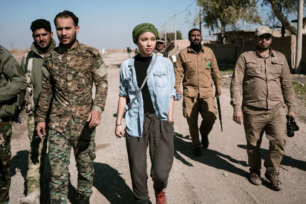 VICE correspondent Isobel Yeung walks with the Badr Brigade, a shia militia, searching for ISIS fighters in one of the last ISIS strongholds in Iraq. | © Courtesy of VICE HBO