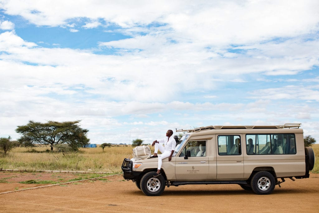 Jessica Nabongo and her journey to travel to every country. Here she poses in the Serengeti in Tanzania | © Elton Anderson