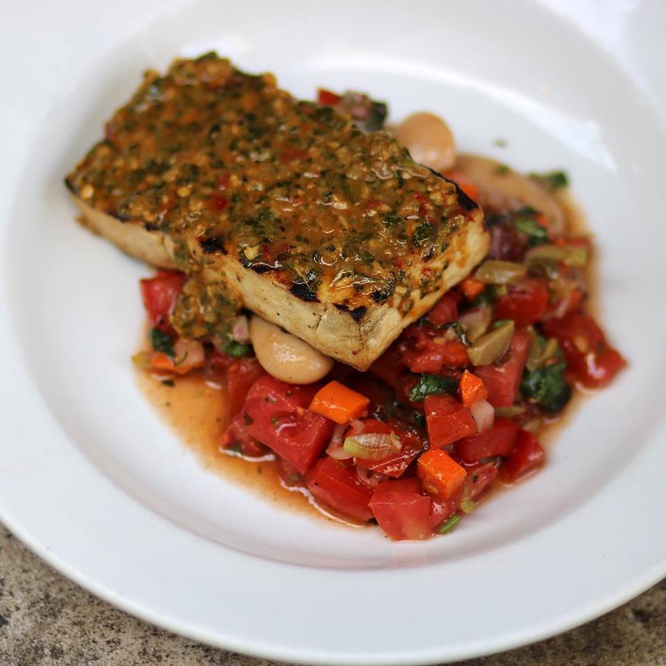 Chermoula Grilled Tofu with white bean salad, fried carrot, and green olive | © V Street Facebook Page