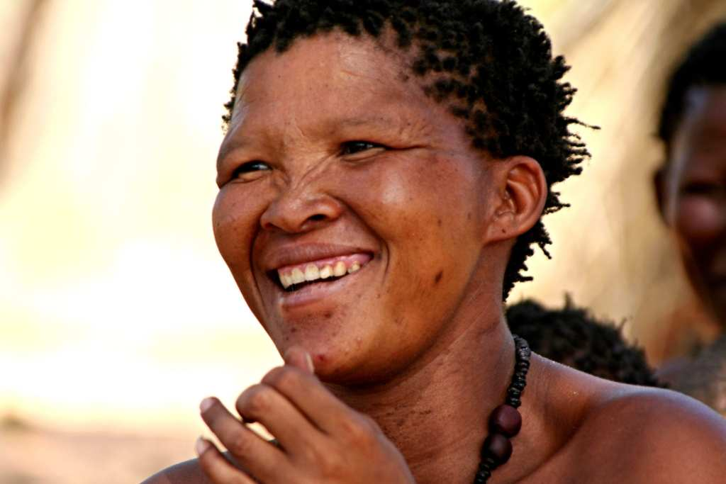 A local San woman smiles in a candid shot | © Rostasedlacek/Shutterstock