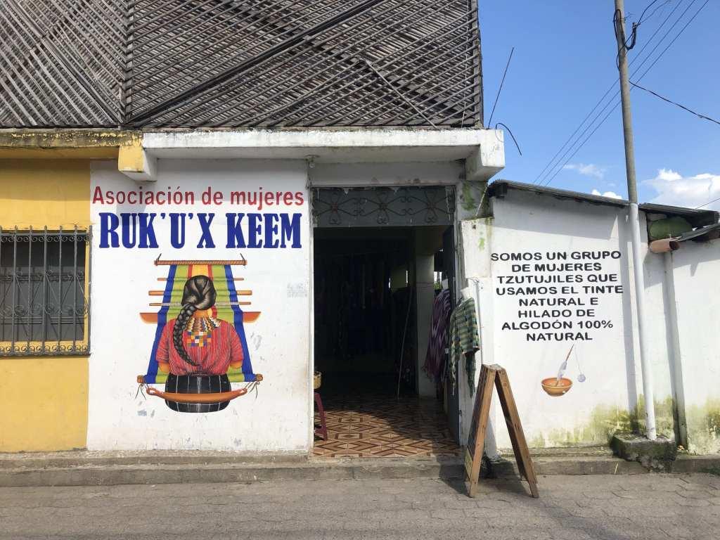 One of many women's association signs in San Juan La Laguna, Guatemala | © Nikki Vargas/Unearth Women