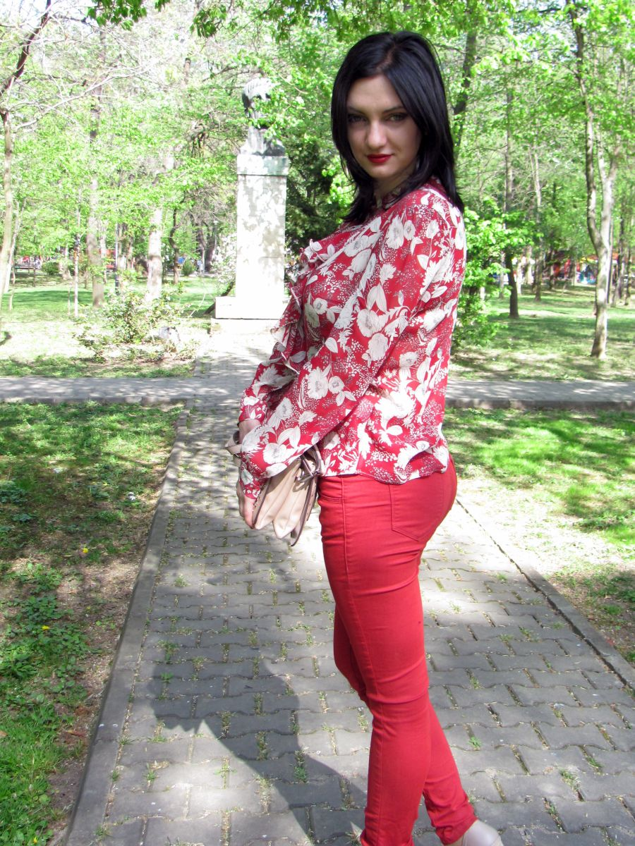 Young woman wearing casual red outfit