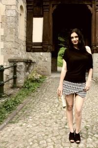 Dark haired girl wearing shorts