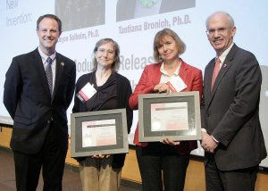 From left are UNeMed President and CEO Michael Dixon, Ph.D., Joyce Solheim, Ph.D., Tantiana Bronich, Ph.D., and UNMC Chancellor Jeffrey Gold, M.D.