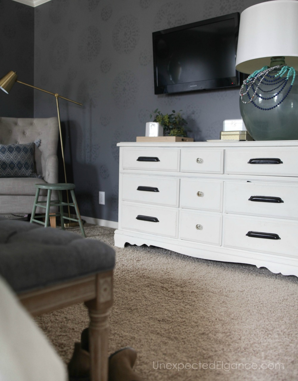 Check out this master bedroom refresh! By using things you already have and cleaning out the clutter, you can have a new space without spending any money!