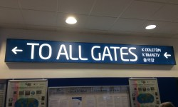 A photo of a sign pointing to all airport gates - Prague, Czechia