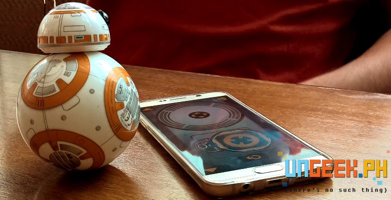 BB-8 checks his controls -- well and the phone as well. :D