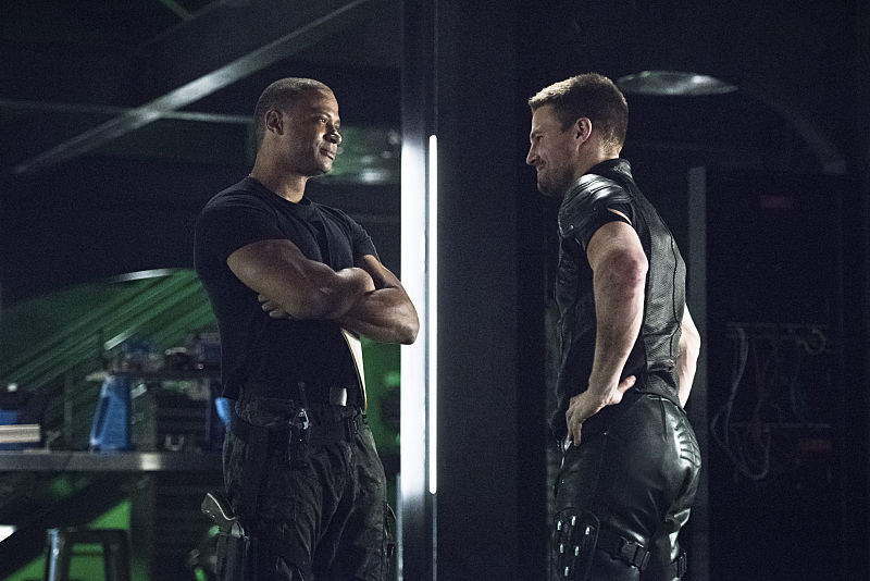 "Arrow -- ""Brotherhood"" -- Image AR407A_0084b.jpg -- Pictured (L-R): David Ramsey as John Diggle and Stephen Amell as Oliver Queen -- Photo: Dean Buscher/The CW -- © 2015 The CW Network, LLC. All Rights Reserved."