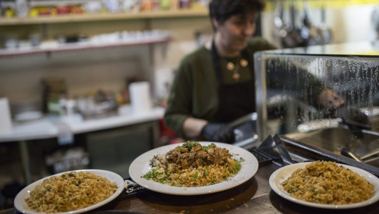 Greece. The island restaurant where refugees cook for locals