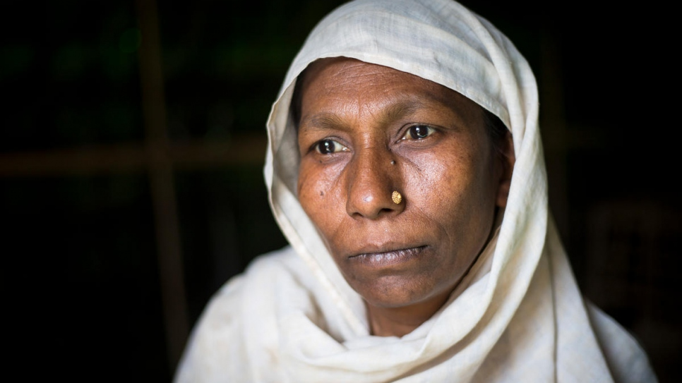 Rohingya refugee Ayesha Begum, 40, poses for a photo in the family's shelter in Bangladesh.