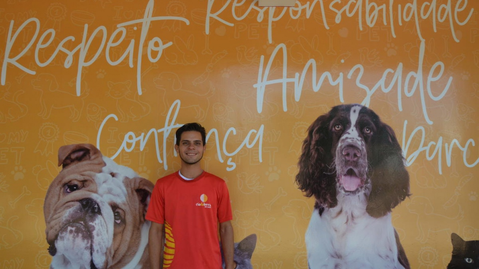 Asylum-seeker Rolando, 25, from Venezuela works as general services assistant at Petshop Cia da Terra in Brasilia, Brazil.
