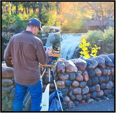 October 25: Artist capturing Minnehaha Falls in late afternoon light, Minneapolis.