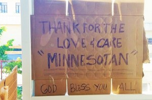 Workers tore up a cardboard box and put a thank you sign in the hospital window.