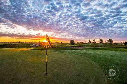 August 31: King's Walk Golf Course: Sun peeking through the flag on Hole No. 8.