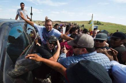 Photo released by Morton County Sheriff's Department of security person pushed against his vehicle. Source unknown. The Sheriff's Department was not at the scene at the time.