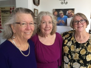 My two older sisters, June, Sharon and me (from left). Together, we've lost more than 200 pounds this year. This photo was taken on the 20th anniversary of buying our grandparents' farm in rural Minnesota. In the background, is a photo of our larger selves taken four years previously.