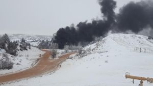 Smoke from the oil burning in Ash Coulee Creek on Dec. 24, 2016. The site is about nine miles north of Theodore Roosevelt National Park's South Unit.