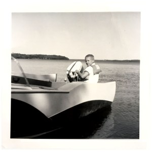 Me, on the boat Hugo built. Made of wood. A cousin of mine and I wish we still had that boat.