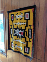"""Yellow rug, woven by Bessie Little, is titled """"Storm"""" and is from the historic LaFont Collection."""