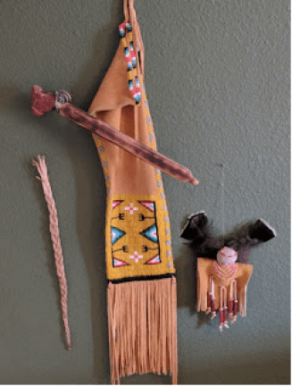 Pipe from Pipestone National Monument in Minnesota with a Lakota pipe bag and doll.
