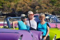 Beauties: Three women from our group pose by a row of colorful old U.S. cars serving as the ubiquitous Cuban taxis.