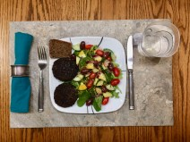 Supper: Two grilled venison patties looking rather dark but quite tasty along with a fresh mixed green salad with flail and balsamic vinegar with water.