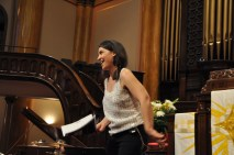 Abbie Betinis, a St. Paul composer and co-editor of the songbook, let the Justice Choir in one of her songs.
