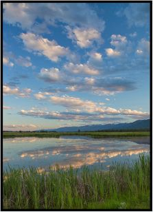 June 26: Nature At Its Best —Clouds and reflections south of Missoula a few days ago.