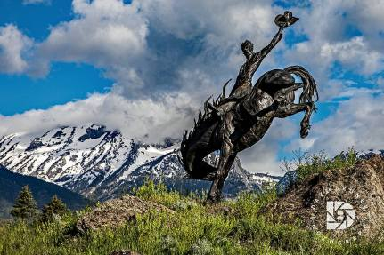 "June 24: ""Wyoming Teton Valley Scenics."" Yee Haw. Ride 'em cowboy statue."
