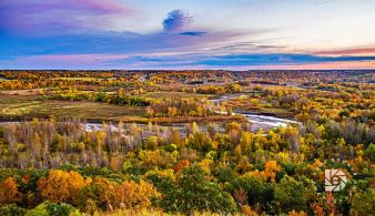 """""""Pembina Gorge Sunset"""": I took a wide shot of the Pembina Gorge with the river winding around the colorful fall trees foliage."""